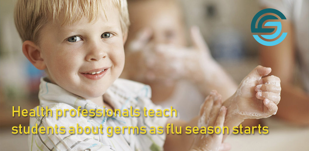 Health professionals teach students about germs as flu season starts